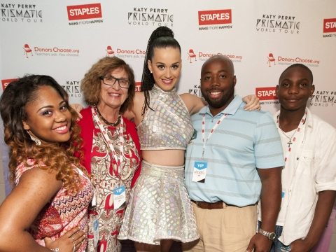 """Global pop star Katy Perry, center, with local teachers and students, left to right, Tiara Brooks, Pauline Weisz, Matthew Hall and Jaylin Barber, backstage at the Philips Arena during her Prismatic World Tour performance on Saturday, June 28, 2014, in Atlanta, Georgia. As part of its $1 million dollar donation to online charity DonorsChoose.org, Staples announced it has fully-funded the balance of every project on DonorsChoose.org in the Atlanta, GA community. This $128,158 donation helped 77 teachers fulfill classroom needs and helped more than 8,779 students in the Atlanta public school district. Katy Perry teamed up with Staples and DonorsChoose.org to """"Make Roar Happen"""" and support teachers during this back-to-school season. (Photo by Dan Harr/Invision for Staples/AP Images)"""