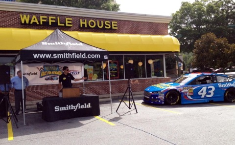 Richard Petty Motorsports No. 43 driver Aric Almirola announces the launch of a digital consumer loyalty program from Smithfield and Waffle House (Photo: Business Wire)