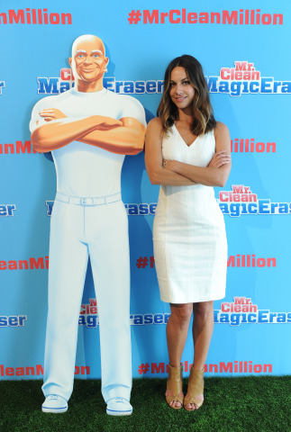 Celebrity hair and make-up artist Sunnie Brook strikes a pose with Mr. Clean at the brand's Summer Fashion party, Tuesday, July 1, 2014, in New York. The event, hosted by stylist Brad Goreski, showcased that there are about a million uses for the famed Magic Eraser, including those in fashion, beauty and beyond. (Diane Bondareff/Invision for Mr. Clean)