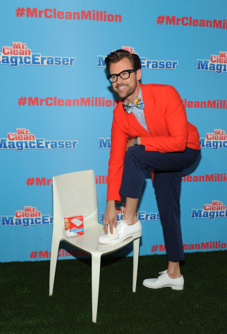 Celebrity stylist Brad Goreski uses a Mr. Clean Magic Eraser to keep his stylish sneakers white, one of his tricks of the trade, before hosting the Mr. Clean Summer Fashion Party, Tuesday, July 1, 2014, in New York. The event showcased that there are about a million uses for the famed Magic Eraser, including those in fashion, beauty and beyond. (Diane Bondareff/Invision for Mr. Clean)