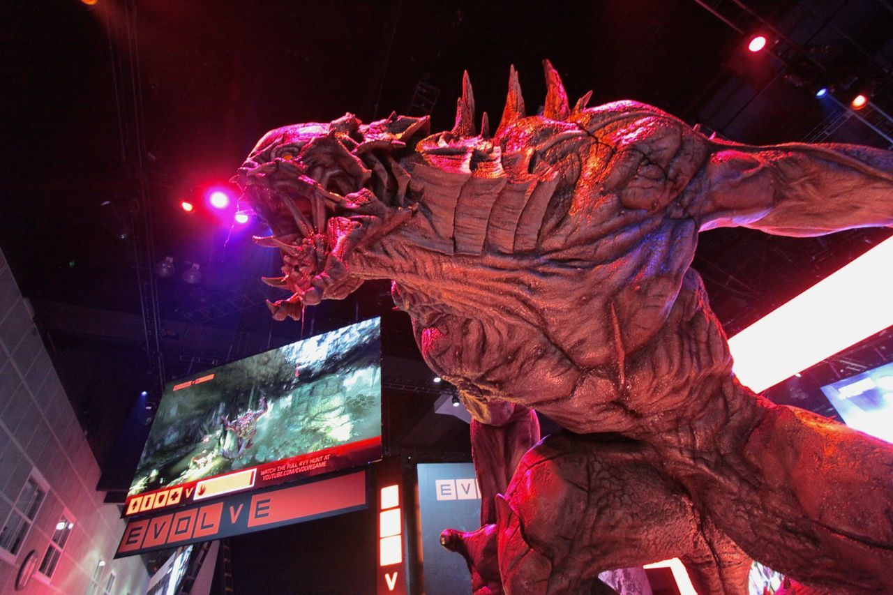 Evolve captivated attendees at the 2014 E3 Show in Los Angeles. Here a 30-foot monster stands in 2K's booth where attendees lined-up for hours each day to play the upcoming game. (Photo: Business Wire)