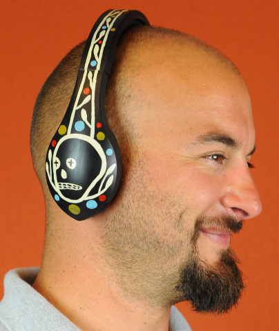 Andrew White wearing a headphone with Art Skin (Photo: Business Wire)
