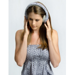 Nicole Heeren wears headphones that match her dress (Photo: Business Wire)