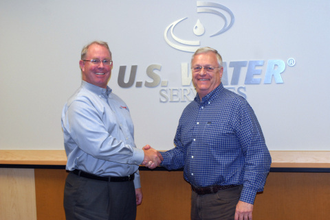 U.S. Water Founder & CEO Allan Bly (L) shakes hands with ChemCal CEO Steve Dumler (R) to confirm the corporate merger. (Photo: Business Wire)