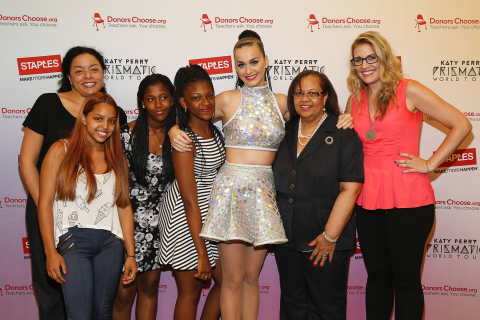 "Global pop star Katy Perry, center, meets with local teachers, left to right, Christine Foyer, local student Krysten Martinez, Dorothy Toure, Jahnay Bryan, Chancelor Dorita Gibson, and local teacher Jennifer Nelson backstage at Madison Square Garden during her Prismatic World Tour performance on Wed., July 9 in New York, N.Y. Staples teamed up with superstar Katy Perry to ""Make Roar Happen"" and celebrate and support teachers during the back-to-school season by donating $1 million to DonorsChoose.org, a charity that has helped fund more than 450,000 classroom projects for teachers and impacted more than 11 million students. (Photo by Mark Von Holden/Invision for Staples/AP Images)"
