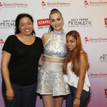 "Global pop star Katy Perry, center, meets with local teacher, left to right, Christine Foyer and local student Krysten Martinez backstage at Madison Square Garden during her Prismatic World Tour performance on Wed., July 9 in New York, N.Y. Staples teamed up with superstar Katy Perry to ""Make Roar Happen"" and celebrate and support teachers during the back-to-school season by donating $1 million to DonorsChoose.org, a charity that has helped fund more than 450,000 classroom projects for teachers and impacted more than 11 million students. (Photo by Mark Von Holden/Invision for Staples/AP Images)"
