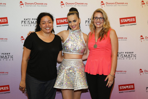 """Global pop star Katy Perry, center, meets with local teachers, left to right, Christine Foyer and teacher Jennifer Nelson backstage at Madison Square Garden during her Prismatic World Tour performance on Wed., July 9 in New York, N.Y. Staples teamed up with superstar Katy Perry to """"Make Roar Happen"""" and celebrate and support teachers during the back-to-school season by donating $1 million to DonorsChoose.org, a charity that has helped fund more than 450,000 classroom projects for teachers and impacted more than 11 million students. (Photo by Mark Von Holden/Invision for Staples/AP Images)"""