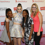 "Global pop star Katy Perry, center, meets with local students, left to right, Jahnay Bryan, Dorothy Toure, and local teacher Jennifer Nelson backstage at Madison Square Garden during her Prismatic World Tour performance on Wed., July 9 in New York, N.Y. Staples teamed up with superstar Katy Perry to ""Make Roar Happen"" and celebrate and support teachers during the back-to-school season by donating $1 million to DonorsChoose.org, a charity that has helped fund more than 450,000 classroom projects for teachers and impacted more than 11 million students. (Photo by Mark Von Holden/Invision for Staples/AP Images)"