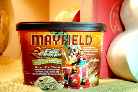 After recently earning two impressive accolades from major media outlets, Dollywood's newest ride now is being commemorated with a special flavor of Mayfield Ice Cream, FireChaser Express Crunchy Caramel Pretzel. Consumers may purchase FireChaser Express Crunchy Caramel Pretzel at Food City, Food Lion, IGA, Ingles, Kroger, Piggly Wiggly, Publix and Wal-Mart locations in Tennessee, Kentucky, Virginia, Georgia, Alabama, North Carolina and South Carolina. (Photo: Business Wire)