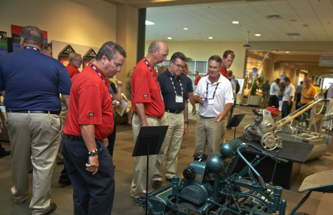 Toro distributors and guests viewing the company's collection of vintage equipment (Photo: The Toro Company)