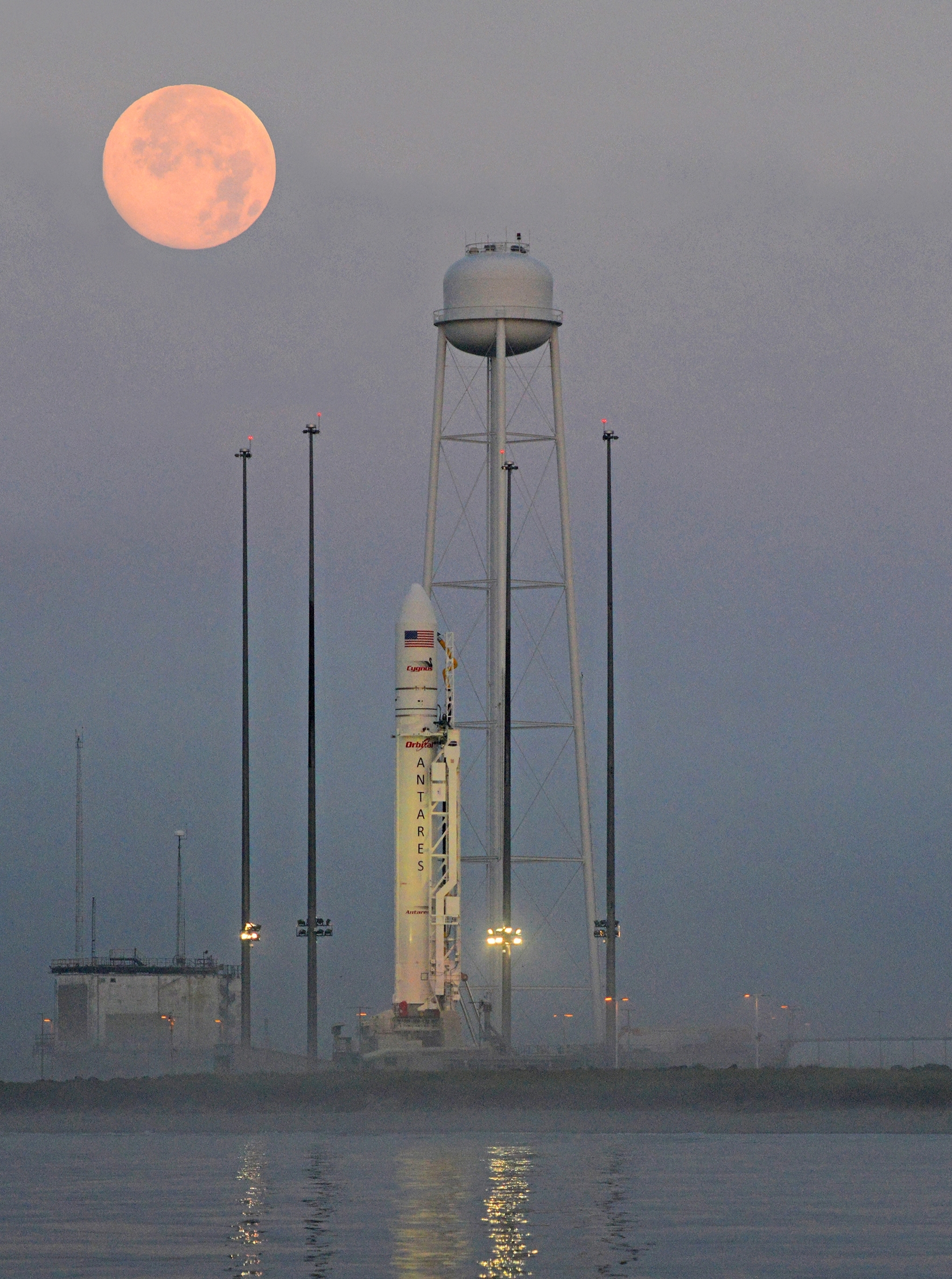 Orbital's Antares rocket on the Mid-Atlantic Regional Spaceport (MARS) Pad 0A at NASA's Wallops Flight Facility, Virginia. Antares is set to launch on Sunday July 13, 2014 carrying the Cygnus spacecraft which will deliver 1,664 kg (3,669 lbs) of cargo to the International Space Station. (Photo: Business Wire)