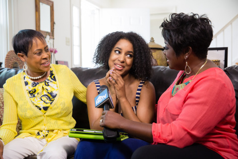 HGTV Smart Home 2014 winner Ashley King (center) shares her excitement with HGTV's Tiffany Brooks (right) and her mother Denise King. (Photo: Charles Chesney/AP Images for Scripps Networks or HTGV)