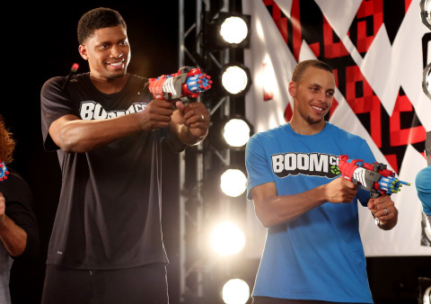 Professional basketball players Stephen Curry and Rudy Gay are partnering with BOOMco. ™, an all-new line of blasters from Mattel. Skilled both on and off the court, Curry and Gay, each leading a team, will go head-to-head the night of Nickelodeon Kids' Choice Sports Awards, in the BOOMco Blaster Challenge. Their precision and accuracy will be put to the test as they blast darts that actually stick to their targets! (Photo: Business Wire)