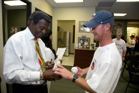 Baseball legend Lou Brock meets patients during the Starkey Hearing Foundation 2014 MLB All-Star Game Hearing Mission at the Starkey Hearing Technologies World Headquarters on July 15, 2014 in Eden Prairie, Minnesota. (Photo by Adam Bettcher/Getty Images for Starkey Hearing Foundation)