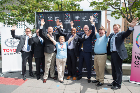LOS ANGELES - JULY 16: Toyota Executives Doug Eroh, Pete Carey, and Michael Rouse; Global Messenger Debi Anderson, ESPN Commentator Jay Harris, ESPN President John Skipper, Global Messenger Dustin Plunkett, and LA2015 President & CEO Patrick McClenahan strike the World Games celebratory pose at the Special Olympics World Games LA2015 Press Conference on July 16, 2014 at LA Live in Los Angeles, California. (Photo by Mpu Dinani/Getty Images)