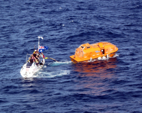 "Nordic River launch boat (R) evacuates injured rower from Avalon rowboat (L) during Indian Ocean rescue led by Global Rescue on July 11. COURTESY OF: LPGC ""Nordic River"" ""K""Line Ship Management Co., Ltd. (Tokyo, Japan)"