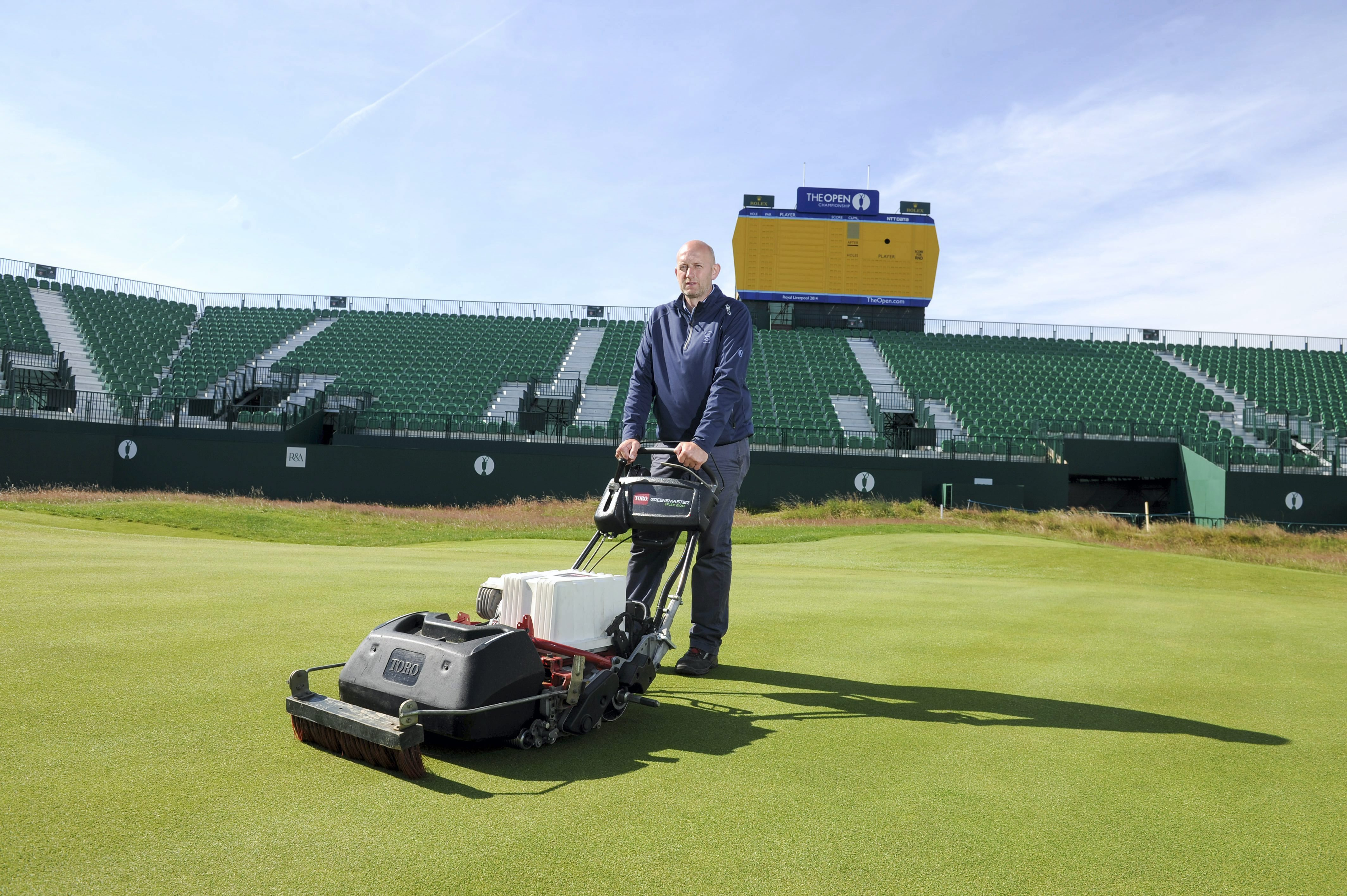 Craig Gilholm, course manager at Royal Liverpool Golf Club, with Toro's eFlex lithium ion battery-powered greensmower. (Photo: Business Wire)