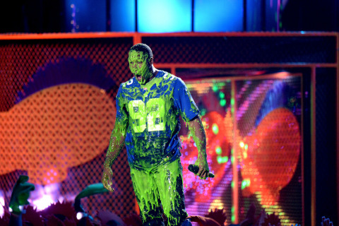 Photo credit: Kevin Mazur/WireImage Host Michael Strahan gets slimed onstage at Nickelodeon's Kids' Choice Sports Awards 2014 at UCLA's Pauley Pavilion on July 17, 2014 in Los Angeles, CA.