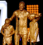 Photo credit: Kevin Winter/Getty Images Soccer player David Beckham (C) with Cruz Beckham (L) and Romeo Beckham (R) get slimed onstage during Nickelodeon Kids' Choice Sports Awards 2014 at UCLA's Pauley Pavilion on July 17, 2014 in Los Angeles, California