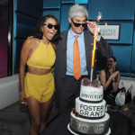 "The Vampire Diaries actress and musician Kat Graham and Foster Grant CEO Cesar Melo celebrate Foster Grant's 85th Anniversary, Thursday, July 17, 2014, at Gansevoort Park Avenue in New York. Graham is the latest star to be featured in the brand's historic ""Who's T"