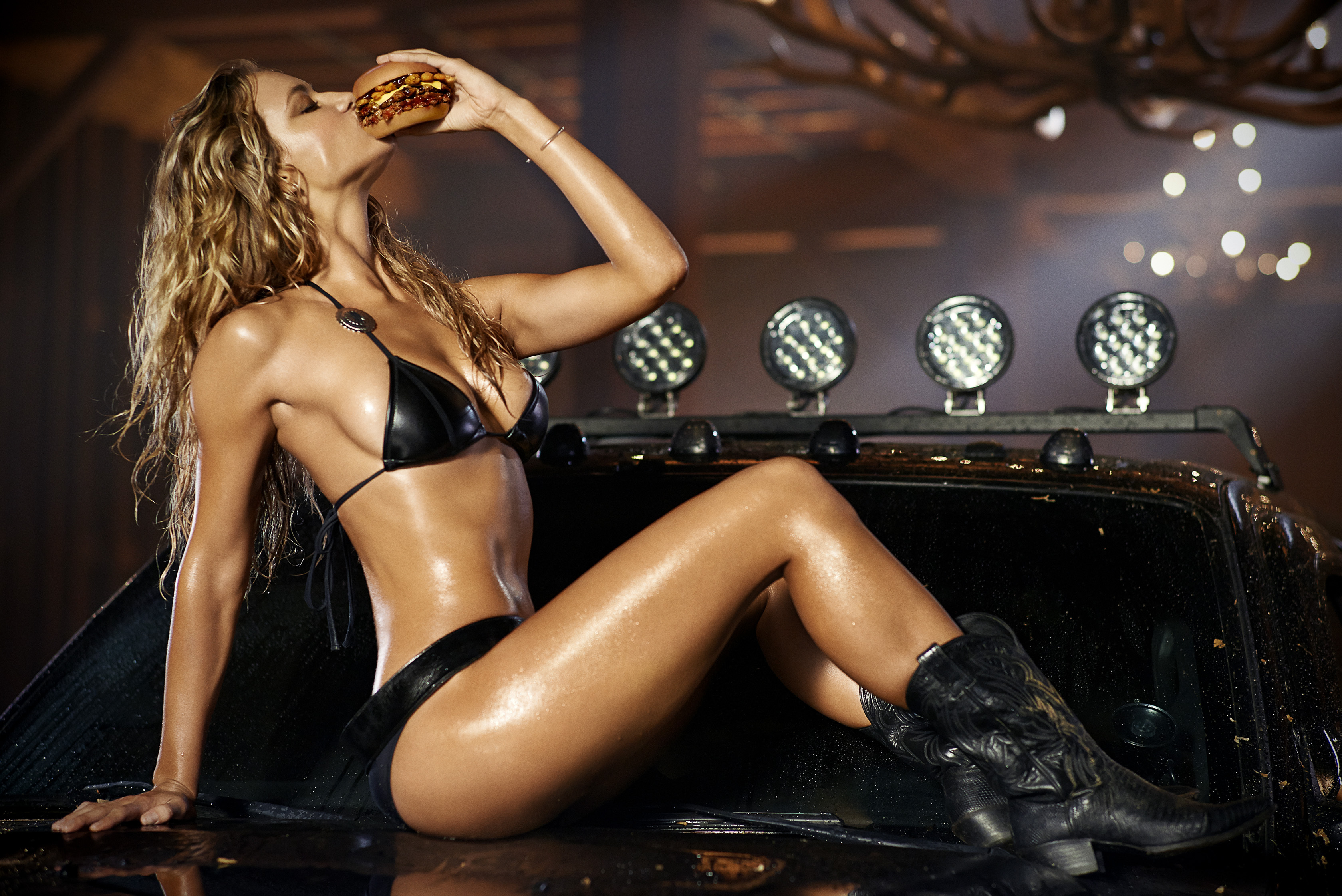 Hannah Ferguson, Texas native and Sports Illustrated swimsuit model, takes the reins as the newest spokesmodel for Carl's Jr. and Hardee's in the Texas BBQ Thickburger ad campaign premiering next week. (Photo: CKE Restaurants & Don Flood)