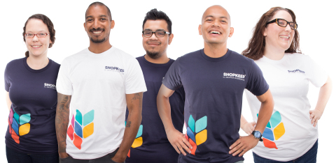 Members of the ShopKeep Customer Care team show off the company's new look and logo. (Photo: Busines ...