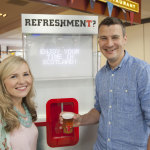 Teacher Craig McGill and wife Zoe were the first to test their chat with the 'water cooler'. (Photo: Business Wire)