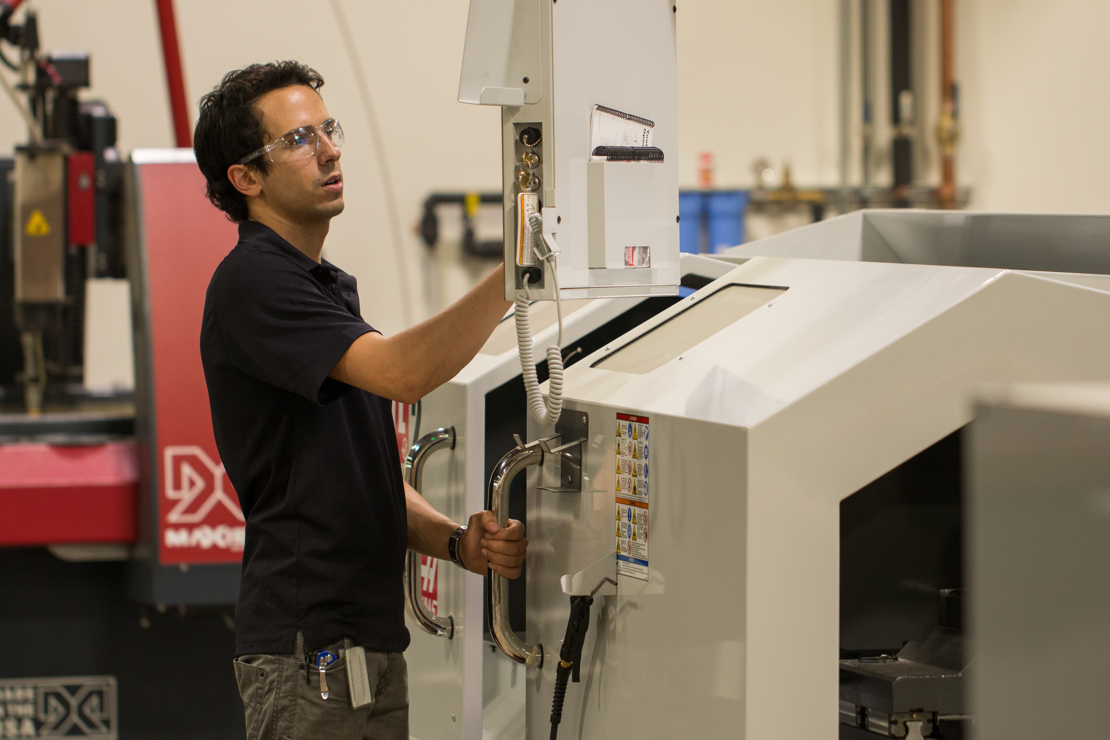 Tomas Garces, community manager, adjusts the axis on the Haas CNC Lathe in the FirstBuild lab, which offers all the tools community members need to bring their ideas to life. (Photo: GE)