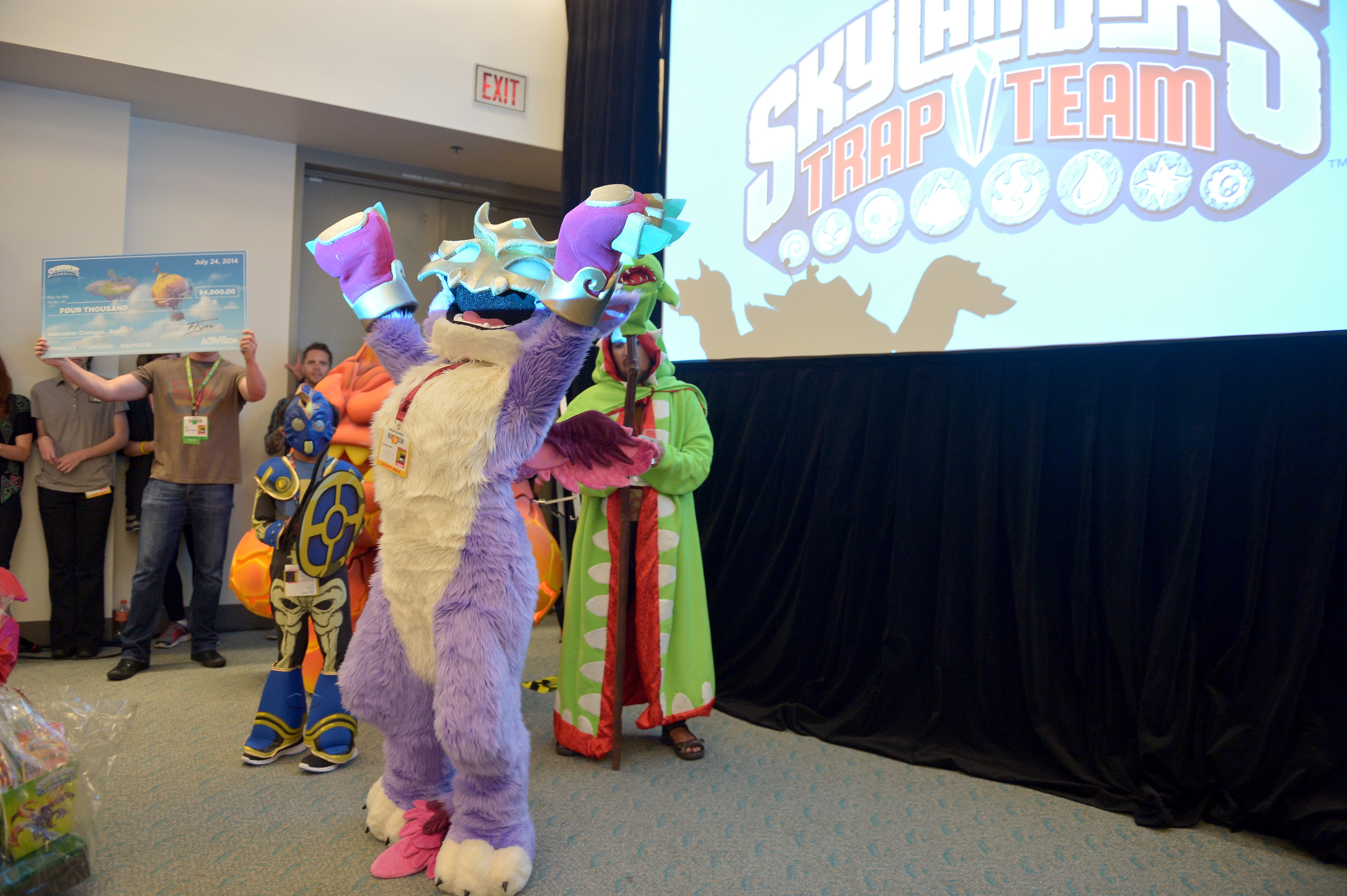 In this photo distributed by Activision Publishing Inc., Skylanders fans celebrate the upcoming launch of Skylanders Trap Team by participating in a costume contest at San Diego Comic-Con 2014 on July 24, 2014 in San Diego, California. Shannon Deeds beat out other contestants for the ultimate prize and bragging rights of being the best costumed character, Scratch. (Photo by Charley Gallay/Getty Images for Activision)