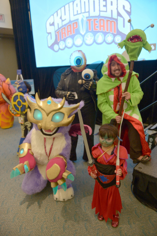 In this photo distributed by Activision Publishing Inc., Skylanders fans celebrate the upcoming launch of Skylanders Trap Team by participating in a costume contest at San Diego Comic-Con 2014 on July 24, 2014 in San Diego, California. For the first time in franchise history, the creators of the Toys-to-Life genre descended upon the convention to showcase the upcoming game Skylanders Trap Team, which reverses the magic and now lets players bring life to toys. The 2 billion dollar franchise also announced a new premium toy line, Eon's Elite at the convention. (Photo by Charley Gallay/Getty Images for Activision)