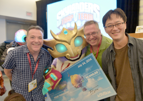 In this photo distributed by Activision Publishing Inc., Skylanders fans celebrate the upcoming launch of Skylanders Trap Team by participating in a costume contest at San Diego Comic-Con 2014 on July 24, 2014 in San Diego, California. Shannon Deeds (2nd L), who beat out other contestants for the ultimate prize and bragging rights of being the best costumed character, Scratch, poses with (L-R) famed voice of Kaos Richard Horvitz, renowned comic book writer Ron Marz and Toys for Bob's Director of Toy and Character Development I-Wei Huang. (Photo by Charley Gallay/Getty Images for Activision)
