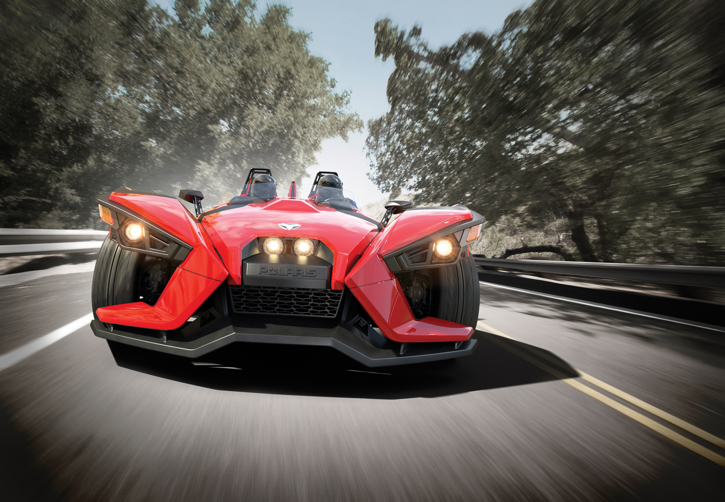 The all-new 2015 Polaris Slingshot - the awe-inspiring 3-wheeled roadster that delivers head-turning exhilaration. Starting at $19,999. Shown in Red Pearl. Photo c/o Polaris Industries.