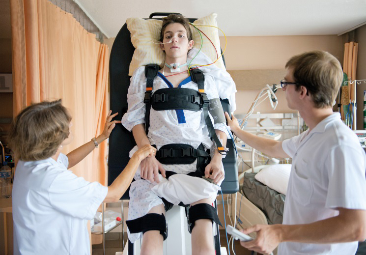 Patient with therapists during the therapy with the ErigoPro. Picture courtesy of the CHUV, Lausanne, Switzerland (Photo: Business Wire)