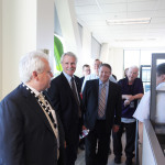 Gov. John Kitzhaber greeting employees during his tour of NuScale Power's Corvallis offices. (Photo: Business Wire)