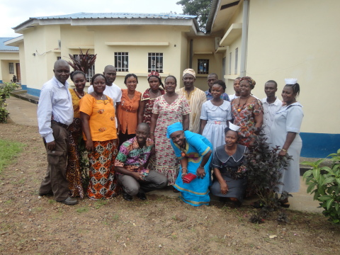AIDS Healthcare Foundation (AHF) Medical Officer Dr. Sheik Humarr Khan (ON FAR LEFT, White Shirt & Khakis), who died at 39 of Ebola Virus Disease (EVD) July 29, 2014 in Sierra Leone, pictured in a group photo with AHF and Sierra Leone Ministry of Health staff during the group's first HIV/AIDS antiretroviral treatment (ART) training for staff and partners in Kenema. The picture, taken by the hall were the training was conducted, was taken on June 20, 2014 during the training, which took place from June 16 to 22, 2014 at the Kenema Government Hospital in the Eastern Province of Sierra Leone. (Photo: Business Wire)