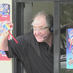 Colorful soccer commentator Ray Hudson surprises fans at the drive thru of a DQ Grill & Chill® Restaurant during the launch of the new Chips Ahoy! ® Blizzard® Treat.