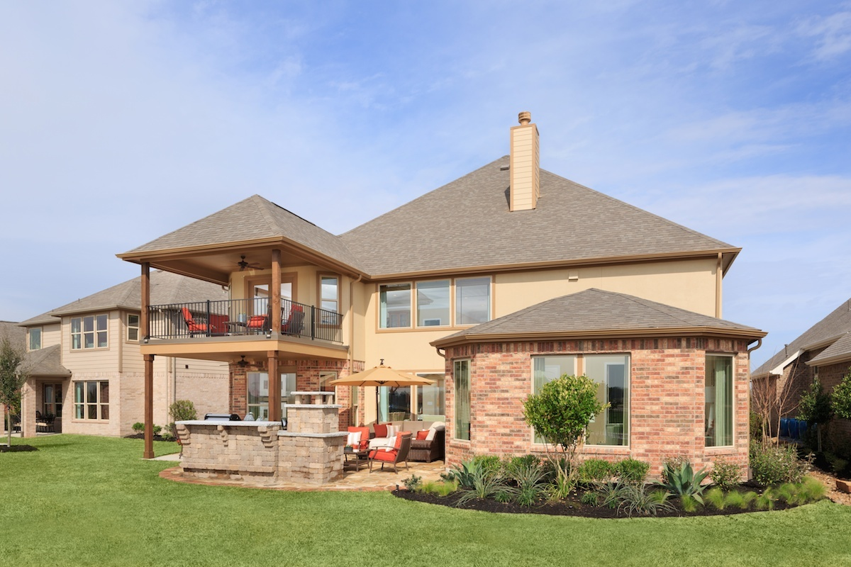 A KB home with a second floor balcony and other outdoor living enhancements modeled at KB Home's Anserra Estates community in Katy, Texas. (Photo: Business Wire)