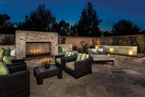 A KB home patio with outdoor fireplace modeled at KB Home's Vicenza at Orchard Hills community in Irvine, Calif. (Photo: Business Wire)