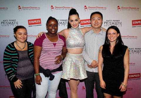 """Global pop star Katy Perry, center, with local teachers and students, left to right, Tajia Reverdes, Janile Campbell, Yu Chen and Amanda Robb backstage at the TD Garden during her Prismatic World Tour performance on Fri., Aug 1 in Boston, Mass. Staples teamed up with superstar Katy Perry to """"Make Roar Happen"""" and support teachers during the back-to-school season by donating $1 million to DonorsChoose.org, a charity that has helped fund more than 450,000 classroom projects for teachers and impacted more than 11 million students. (Photo by Marc Andrew Deley/Invision for Staples/AP Images)"""