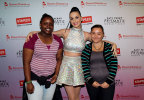 """Global pop star Katy Perry, center, with local students, left to right, Janile Campbell and Tajia Reverdes backstage at the TD Garden during her Prismatic World Tour performance on Fri., Aug 1 in Boston, Mass. Staples teamed up with superstar Katy Perry to """"Make Roar Happen"""" and support teachers during the back-to-school season by donating $1 million to DonorsChoose.org, a charity that has helped fund more than 450,000 classroom projects for teachers and impacted more than 11 million students. (Photo by Marc Andrew Deley/Invision for Staples/AP Images)"""