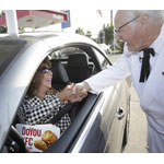 "KFC touts new $5 Fill-Up meals with surprise food and fuel fill-ups from ""Colonel Sanders"" for customers at a local service station on Tuesday, July 29, 2014 in Louisville, Ky. (Photo by Tony Tribble/Invision for KFC/AP Images)"