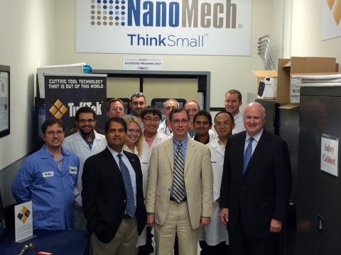 Dr. Timothy Persons tours NanoMech's factory and labs accompanied by some of the company's scientist ...
