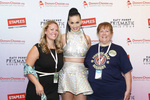 """Global pop star Katy Perry, center, with local teachers, left to right, Caitlin Matyas and Barbara Janas backstage at the Wells Fargo Center during her Prismatic World Tour performance on Tuesday, August 5, 2014 in Philadelphia. Staples teamed up with superstar Katy Perry to """"Make Roar Happen"""" and celebrate and support teachers during the back-to-school season by donating $1 million to DonorsChoose.org, a charity that has helped fund more than 450,000 classroom projects for teachers and impacted more than 11 million students. (Photo by Mark Stehle/Invision for Staples/AP Images)"""