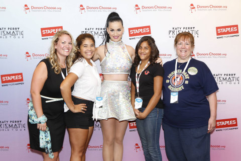 """Global pop star Katy Perry, center, with local teachers and students, left to right, Caitlin Matyas, Mia Vega, Jocelyn Santiago and Barbara Janas backstage at the Wells Fargo Center during her Prismatic World Tour performance on Tuesday, August 5, 2014 in Philadelphia. Staples teamed up with superstar Katy Perry to """"Make Roar Happen"""" and celebrate and support teachers during the back-to-school season by donating $1 million to DonorsChoose.org, a charity that has helped fund more than 450,000 classroom projects for teachers and impacted more than 11 million students. (Photo by Mark Stehle/Invision for Staples/AP Images)"""