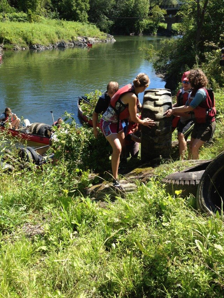 Keurig Green Mountain employees pull tires out of the Winooski River during last year's River Clean-Up week in Vermont. In total, employees removed 370 tires. (Photo: Business Wire)