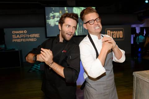 "Rival chefs Marcel Vigneron, left, and Richard Blais participate in the ""Top Chef Duels"" Premiere Tasting Event, hosted by Chase Sapphire Preferred and Bravo, at the Altman Building, on Monday, Aug. 4, 2014 in New York. (Photo by Evan Agostini/Invision for Chase Sapphire Preferred/AP Images)"
