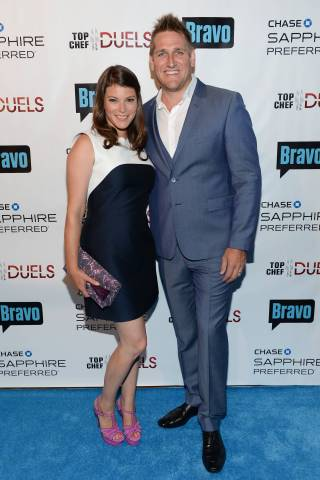 """Judge Gail Simmons, left, and host and judge Curtis Stone attend the """"Top Chef Duels"""" Premiere Tasting Event, hosted by Chase Sapphire Preferred and Bravo, at the Altman Building, on Monday, Aug. 4, 2014 in New York. (Photo by Evan Agostini/Invision for Chase Sapphire Preferred/AP Images)"""