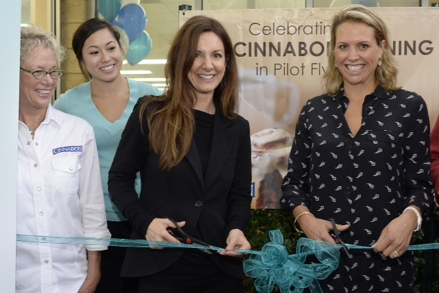 Cinnabon President Kat Cole and Whitney Johnson, director of brand and customer experience at Pilot Flying J, celebrate Cinnabon's 100th opening with the travel plaza chain in Mebane, North Carolina. (Photo: Business Wire)