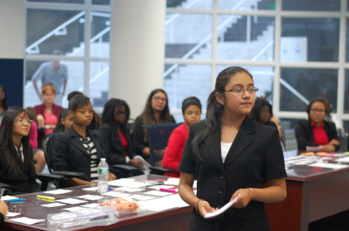 Odalys Garcia (front), a rising freshman in NJ LEEP's College Bound Program, conducts a direct examination of her witness during the Championship Round at NJ LEEP's Mock Trial Competition at Seton Hall Law School. (Photo: Business Wire)