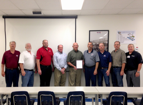 Pictured from Left to Right: Ron Valentine (QC Manager), Gary Foy (Materials Manager), Dennis Wilson (EHS Manager), Todd Smith (Plant Manager), Steve Smith (retired Plant Manager), Jay Bills (Superintendent), Mike Egbert (Plant Engineer), Joe Maylin (HR Manager), and Robert Gardner (Liberty Mutual)(Photo: Business Wire)